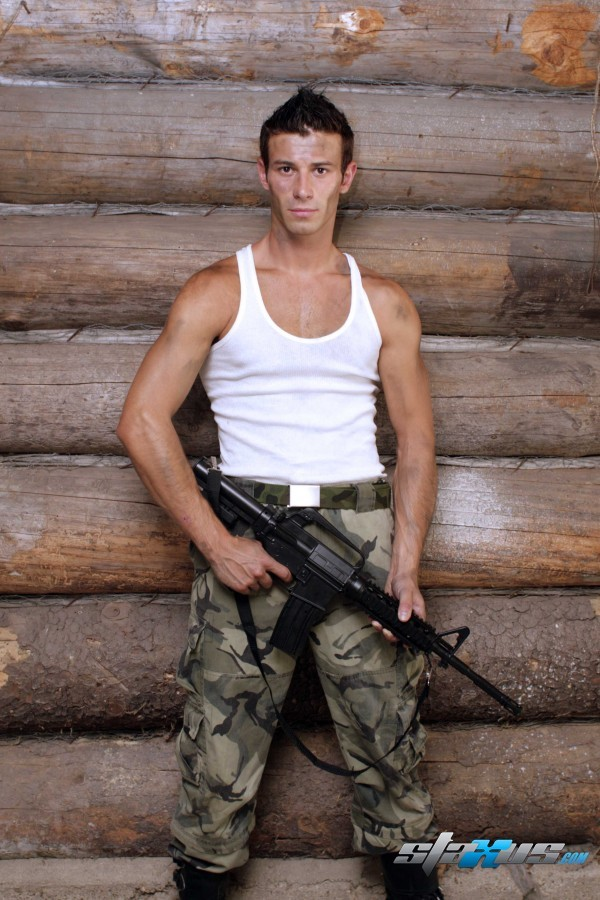 gay boy Kamil Fox with gun in army form