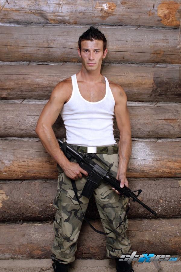 gay boy Kamil Fox with gun in army form